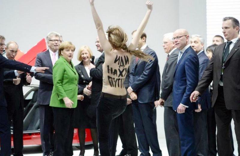 FEMEN give Putin and Merkel an eyeful in Hanover - YouTube
